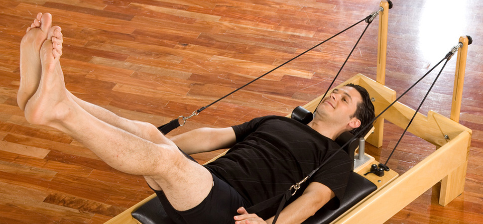 Cours particulier Pilates reformer homme